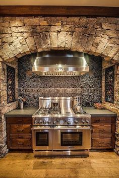 I love the space next to the stove, the drawers, and the spice racks inside the brick wall.