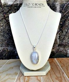Natural, untreated moonstone from Sri Lanka set in a silver alloy, non tarnish setting with a sterling silver chain. Stone is approximately 40