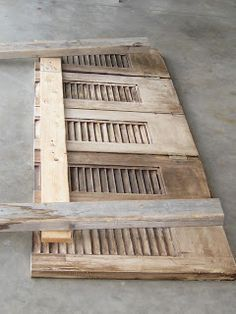 Restored Treasures Too: Distressed headboard made from old shutters!