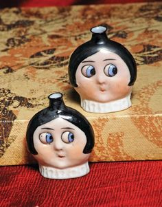 PAIR OF GOOGLY-EYED PERFUME FLASKS. BY HERTWIG. Ma
