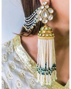 Add a little glam to your Indian wedding outfit by wearing these chic earrings. You can pair these trendy and classy earrings with any ethnic attire. OTT earrings will surely take your reception/haldi/mehndi/wedding outfit a notch higher. Indian Jewelry Earrings, Indian Jewelry Sets, Jewelry Design Earrings, Indian Jewellery Design, Indian Wedding Jewelry, Bridal Earrings, Indian Bridal, Bridal Jewelry, Handmade Jewellery