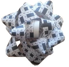 A gift bow, made from our very own Lovatts puzzle pages.