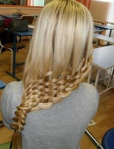 We have no idea how they did it, but we're in awe over this basket weave braid.
