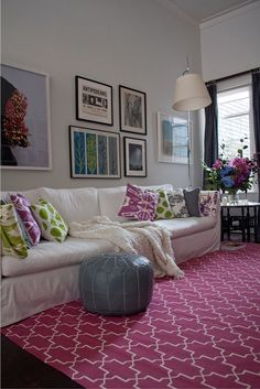 Here the white and vibrant colors are both on large surfaces-the white is on the walls, ceiling and sofa and the violet is in the geometric rug...