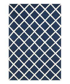 Dark blue & ivory wool Ariel rug on Zulily.