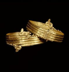 Pair of wrist bracelets in the form of coiled snakes.  Artist/Maker(s): Unknown.  Culture: Greek.  Place(s): Alexandria, Egypt (Place created).  Date: 220 - 100 B.C.  Medium: Bracelets: Gold; Fastening pin: Copper alloy.