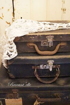 Stack of vintage brown suitcases Repinned by www.silver-and-grey.com