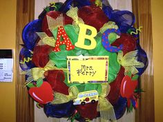 Back to school wreath was a special custom order done by Suzy Whitaker. Love the primary colors! You can see more of her work on her Wreaths by Suzanna Facebook page.    See more Back to School Wreaths on our Blog www.trendytree.com