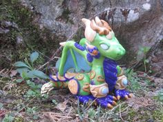 World of Warcraft Inspired: Ysera the Dreamer by TheTallGrass  Based of the Dragon Aspect, Ysera, from World of Warcraft, this beautiful dragon is handmade from polymer clay and is fashioned in the same style and size as our Tarecgosa model.   Ysera measures 3.5in tall, 2.5in wide and 3.5in long, though size will vary slightly with each model as they are all handmade on order :)