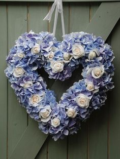 Wreath of blue hydrangeas and ivory roses, Lily & May