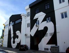 An entire block of buildings located at the Zavrtnica business center in Zagreb, Croatia has received a unique facelift treatment by the architect of Brigada Agency. A series of bold typographic elements were painted over the exterior walls of the complex turning it into some sort of Typography Heaven.