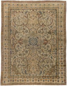 Antique Persian Rug Tabriz with floral  ornaments. Interior living room decor…