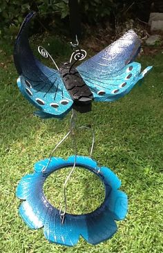 Recycled tire swallowtail butterfly with a recycled Tire Bird Feeder from www.cooltireswings.com