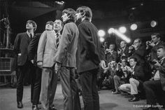 The Beatles are seen here with Ed Sullivan on Feb. 9, 1964, in a photo taken by Bill Eppridge. The renowned photojournalist's images of The Fab Four are on view in a new show opening this week at Western Connecticut State University in Danbury. From left are Paul McCartney, John Lennon, Ed Sullivan, George Harrison and Ringo Starr. Photo: Bill Eppridge / Contributed Photo / ©The Estate of Bill Eppridge. All Rights Reserved.  No reproduction without permission of the Estate of Bill Eppridge.