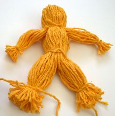 How to Make a Yarn Doll: 9 Steps (with Pictures) - wikiHow.  Nice pictures.  Would work well for group activity or even self directed younger kids.