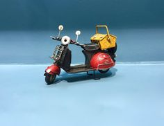 Vintage scooter vespa miniature, decorative collectible with picnic bag on its back,retro collection