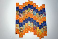bargello with paper. try with torn edge as well