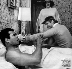 """Niki Lauda and Muhammad Ali, 1977 The little text reads: """"The Formula 1 champion shows the box champion his left hook. Not everybody is allowed to make such jokes with Ali, but the fact that, Lauda came back from his life threatening injuries to become World Champion even impressed Ali"""