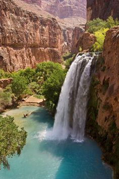"""""""One of the most visited falls in the Grand Canyon, Havasu Falls leaps spectacularly over a 120-foot (37 m) vertical cliff. The water is highly mineralized, and its erosive powers cause the occasional division of the falls into two chutes as well as having created the blue-green pools below...."""""""