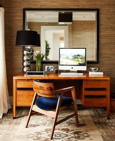 Wood desk in earthy home office with midcentury modern pieces