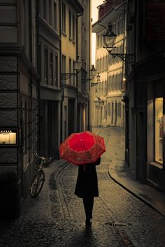 Walking with red umbrella