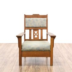 This antique arts & crafts style accent chair is featured in a solid wood with a rustic oak finish. This Morris style armchair has a carved back, light blue upholstered seat cushions and nailhead trim. Eye catching chair perfect for a cozy cottage! #countryfarmhouse #chairs #accentchair #sandiegovintage #vintagefurniture