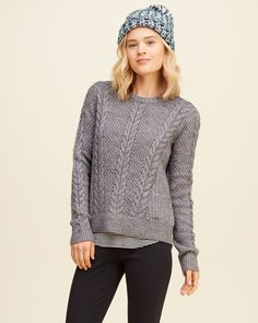 Girls Cable Crew Sweater | Crafted with classic cable pattern with an easy silhouette, featuring a relaxed crewneck, ribbed trims and a logo detail at hem, Easy Fit | HollisterCo.com