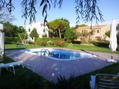 "Swimming pool and the ""rustic farmhouses"" still in its natural state"