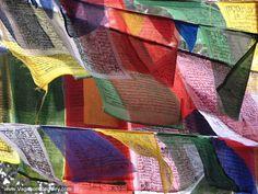 Tibetan prayer flags in Dharamshala. Via http://www.VagabondJourney.com