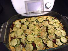Polenta au pistou, tomates séchées et courgettes