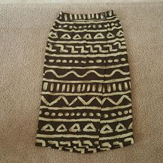 "Wrap skirt A very nice wrap skirt. Tribal print.  Button waist. Hardly worn.  Great condition. Skirt is 34"" long. Liz Claiborne Skirts Maxi"