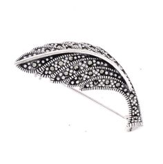 Marcasite Leaf Brooch €75.00 This pretty leaf brooch would make an ideal gift for anyone.  Worn on the lapel of a coat, a dress or scarf it will add some subtle sparkle.   This vintage style brooch is set with marcasite in sterling silver and hallmarked in the Dublin Assay Office.  The perfect 1920's style fashion accessory. Vintage Style, Vintage Fashion, Marcasite Jewelry, Dublin, Brooches, Style Fashion, Fashion Accessories, Sparkle, Leaves