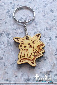 Laser cut and engraved Pikachu wood keyring. By TwikiConcept on Etsy