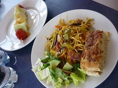 UK. Pasta with peppers and onions, salad, focaccia, water and fruit kebab