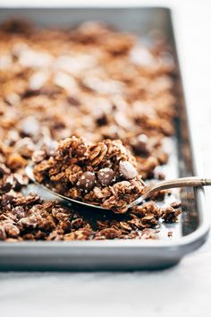 The Ultimate Chocolate Granola - made with oats, almonds, coconut flakes, chocolate chips, and topped with crunchy turbinado sugar and sea salt. Perfect for gifting to friends... or to yourself.