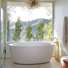 Sunday Morning Soak with This View! @sarahshermansamuel @archdigest #archdigest #instahome #interiordesign #bathroomdecor #bathroom…