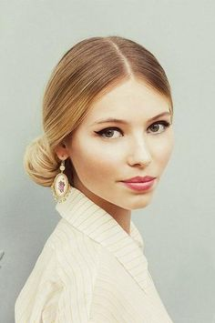 Consider winged liner and a soft berry lip for a chic and sophisticated Fall wedding look.