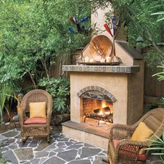 Style Guide: 61 Breezy Porches and Patios | Garden Patio | SouthernLiving.com  An outdoor fireplace, decorated with items that the homeowner acquired in his travels through the Southwest, dominates this sunken garden patio.