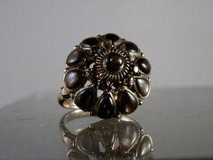 Black star sapphire thai princess ring.  https://www.etsy.com/listing/201041116/vintage-black-star-sapphire-and-14k
