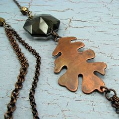 Tiered Asymmetrical necklace with oak leaf and by Adornments NYC
