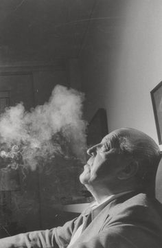Image 1 of 10 from gallery of Mies, the Modernist Man of Letters. Mies van der Rohe with smoke, photographed for Life magazine. Image Courtesy of Frank Scherschel/Time & Life Pictures/Getty Images Walter Gropius, Ludwig Mies Van Der Rohe, Bauhaus, Philip Johnson, Christian De Portzamparc, Metropolis Magazine, Kenzo Tange, Men Of Letters, Oscar Niemeyer