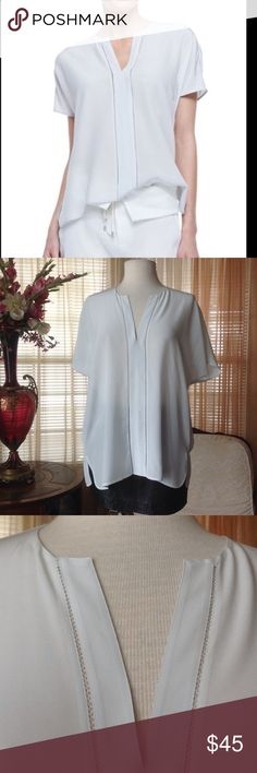 Vince silk top In excellent condition. Looks new without any defects. Color is not white but there is a little greenish tint to it.. Bundle and save.                                                        d Vince Tops Blouses