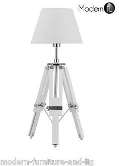TRIPOD TABLE LAMP WITH WHITE SHADEProduct Description The tripod table lamp…
