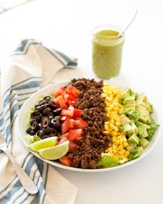 This {skinny} taco salad with avocado cilantro dressing is gluten & dairy free, stuffed with tons of vibrant veggies, plus a homemade taco seasoning recipe