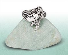 Mermaid Ring: A mermaid will stay on land only with one of her choosing. Show the world your affinity with mermaids by keeping this one close. Sterling silver ring wraps her tail around you.
