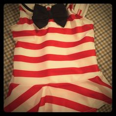NWT! 18-24 months Gymboree swimsuit NWT! 18-24 months Gymboree red and white one piece striped swimsuit with black bow. Features adorable ruffle skirt. Gymboree Swim One Pieces