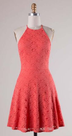 We cannot get enough of this form fitting flared dress! The lace overlay and bright shade of coral are what every summer lover's dreams are made of. Jessie Dress