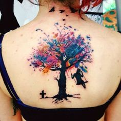 Watercolor Tree Tattoo. Another amazing tree tattoo idea for the girls is water colored piece, that is beautifully done with the girl swinging in the shadow of tree.