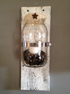 Rustic Mason Jar Sconce by RusticWoodHomeDesign on Etsy, $22.50  Add a rustic fee to any wall with mason jar sconces.  Made from pallet wood and the mason jars attached.  The finish on these are a crackle paint as well as slightly distressed.  Has a very country rustic look.  Candles will be included to place in the top or place in the mason jar itself.  The choice is yours and the possibilities are endless with these mason jar sconces.