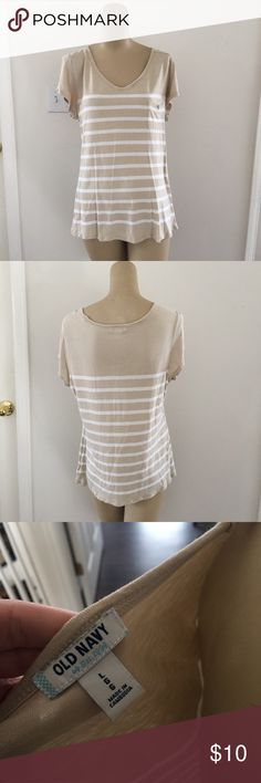 💚 tan and white striped tee Striped tee with a scoop neck. Super soft. Excellent condition.   This is a special item!   Our closet is built on quality and quantity!   We want you to get the most bang for your buck!   Add💚💚💚 three $10 items to a bundle for only $22!  Add 💙💙 two $22 items to a bundle for only $32!  Add 💙 one $22 and 💚 one $10 item to a bundle for only $26! Old Navy Tops Tank Tops